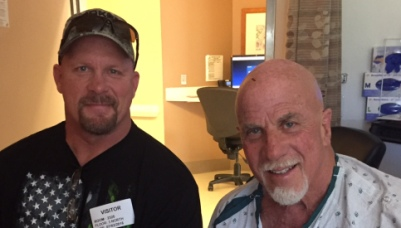 While in the hospital with a health challenge recently, former WWE Champion Steve Austin visited Ric Drasin